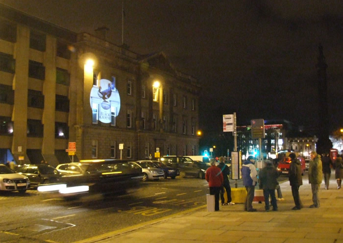 A long shot of a projection on George St in Central Edinburgh